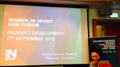 Photo of preparation for NGB Forum on Product development powerpoint presentation and Women in Sport banner