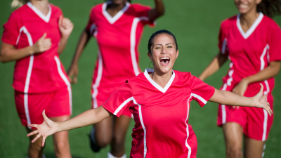 Image of women footballers celebrating a goal
