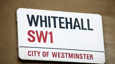 Close up shot of a street sign fro Whitehall, London, SW1, this area is the centre of the British government and includes 10 Downing Street.