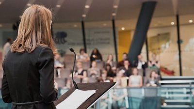 Woman delivering keynote speech
