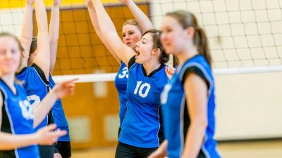 School age girls playing volleyball