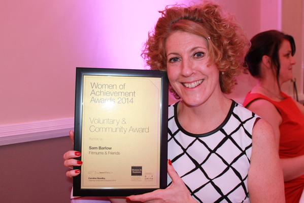 Fitmums and Friends founder Sam Barlow holding Women of Achievement Award 2014 certificate for Voluntary and Community work