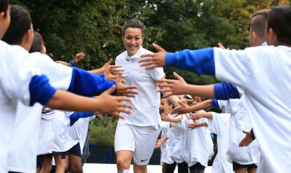 Lucy Bronze with school children at a Sainsbury's Active Kids event