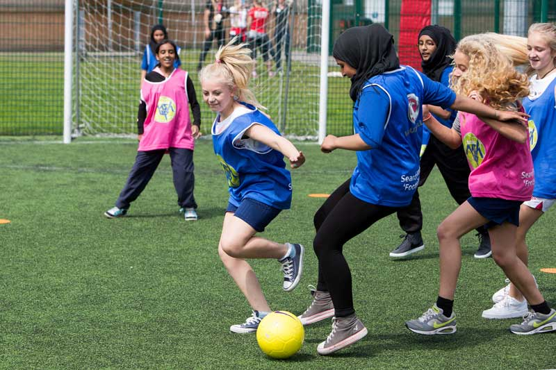 Schoolgirls playing football at Active Inspiration camp