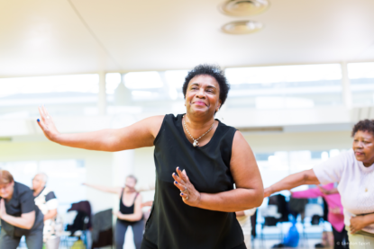 Older woman taking part in dance class