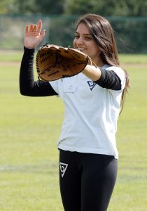 Girl playing baseball with glove