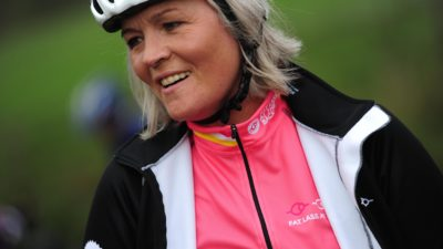 Older woman wearing cycling jacket and helmet