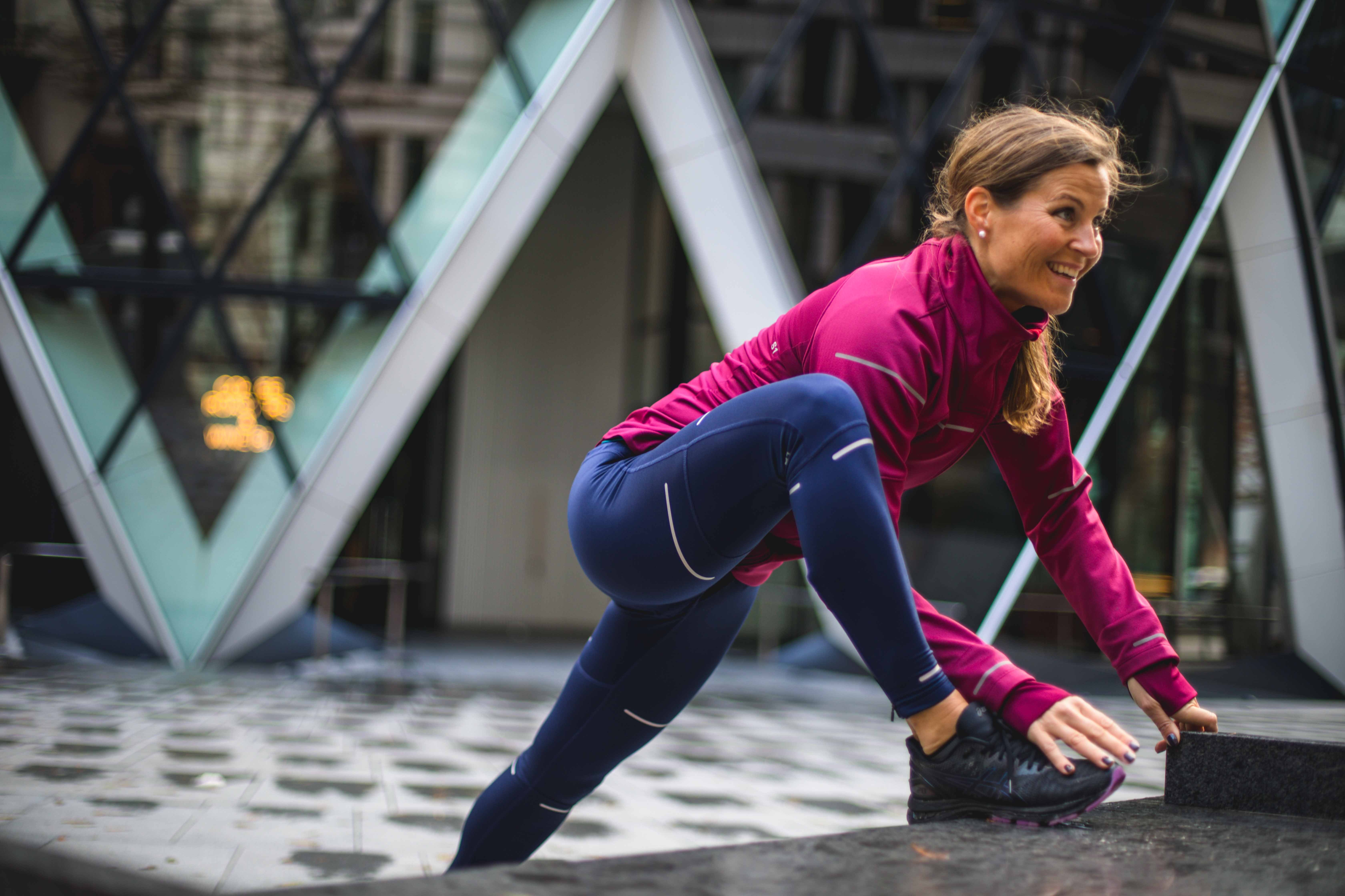 Woman stretching in running clothing