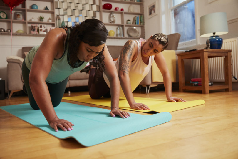 Women doing workout in living room