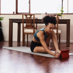 Woman stretching in front of laptop